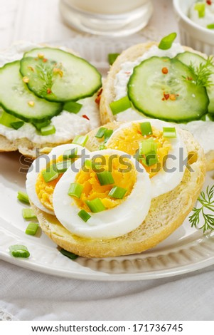 Fresh canapes with egg, cottage cheese, cucumber and herbs. Healthy breakfast