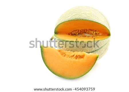 fresh cantaloupe melon and a cut oiece on a white background - stock photo