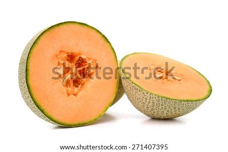 fresh cantaloupe melon cut in half isolated on white  - stock photo