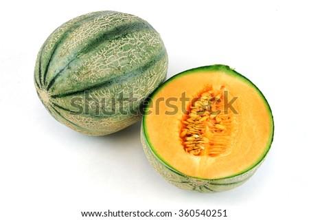 fresh cantaloupe melon on white background - stock photo