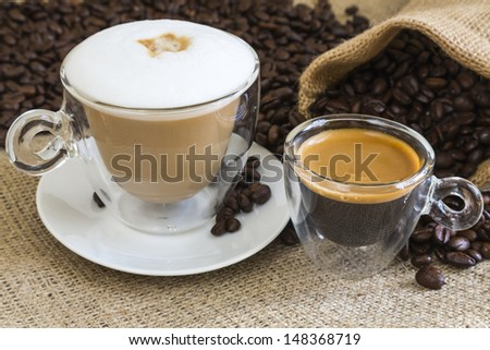 fresh cappuccino and espresso in transparent glassy cups - stock photo