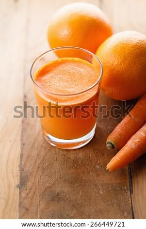 Fresh carrot and orange juice - stock photo