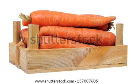 fresh carrot in wooden crate isolated on white - stock photo