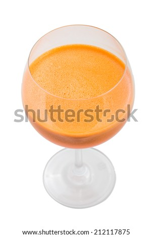 Fresh carrot juice in wine glass isolated on white background - stock photo