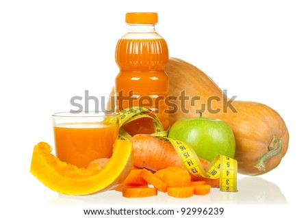 Fresh carrot, pumpkin and apple juice with a measure tape isolated on white background