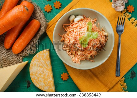 Fresh carrot salad with garlic and cheese. Top view