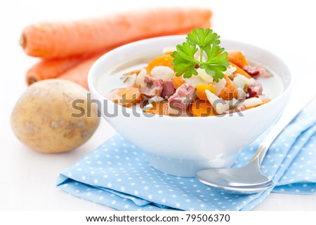 fresh carrot stew with smoked pork and potatoes - stock photo