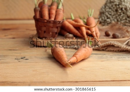 Fresh carrots on the wood background