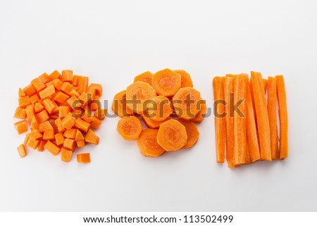 Fresh carrots sliced and diced - stock photo