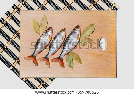 Fresh-caught river fish on a wooden table. Fish table. - stock photo