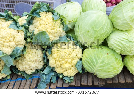 Fresh Cauliflowers and cabbages in the vegetable market stall thailand. - stock photo
