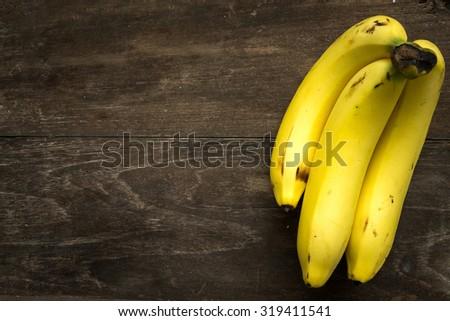 Fresh Cavendish Banana on wooden background - stock photo