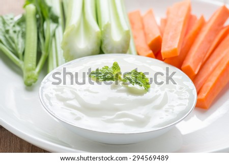 Fresh celery and carrot with yogurt sauce.