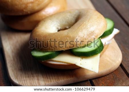 fresh cheese and ham bagel - stock photo