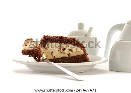 Fresh cheese cake with chocolate and piece of banana - stock photo