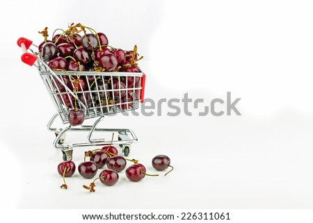 Fresh cherries in a supermarket cart - stock photo