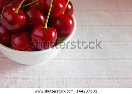 Fresh cherries in bowl - stock photo