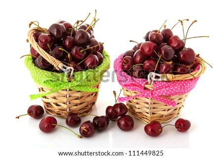 Fresh cherries in colorful little baskets