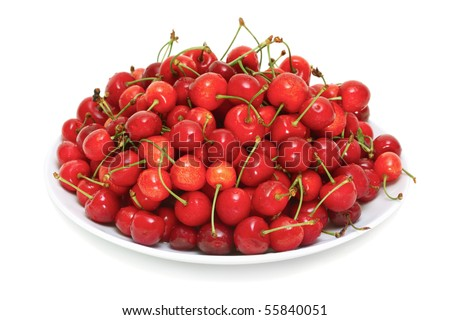 fresh cherries on a plate isolated on white