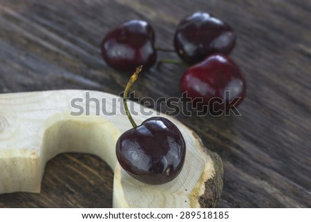 Fresh cherries on wooden background - closeup