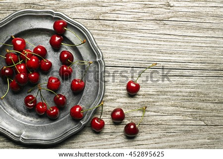 Fresh cherries on wooden table close up - stock photo