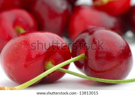Fresh cherries with more cherries in background