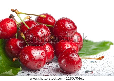 Fresh cherry berries with drops isolated on white - stock photo
