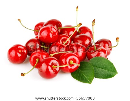 fresh cherry fruits with green leaves isolated on white background