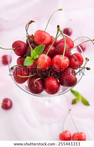 Fresh cherry in a glass, close up - stock photo