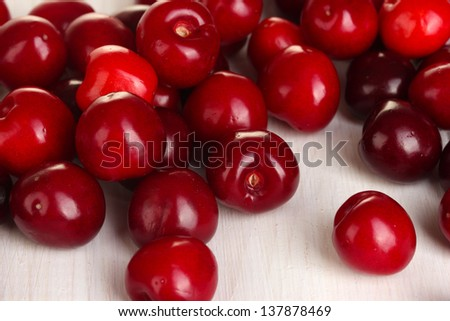 fresh cherry on white wooden table close-up