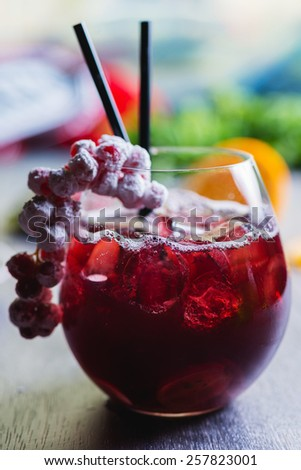 fresh cherry soft lemonade in a glass on a wooden table with decorations focus on different parts of the glass - stock photo