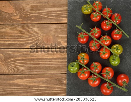 Fresh cherry tomatoes on a brown background - stock photo