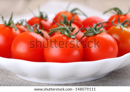 fresh cherry tomatoes on a plate - close up