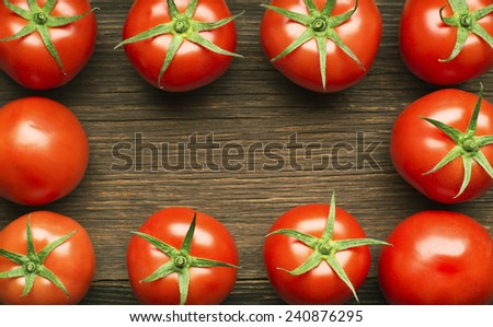 Fresh cherry tomatoes on rustic wooden background - stock photo