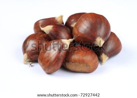 fresh chestnuts on a white background - stock photo