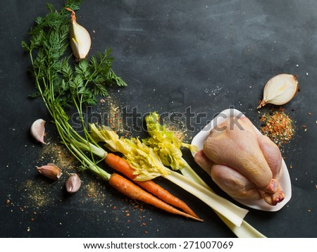 Fresh chicken and vegetables on dark vintage background, selective focus. Healthy food, diet or cooking concept