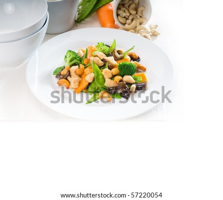 fresh chicken and vegetables stir fried with cashew nuts,typical chinese dish - stock photo