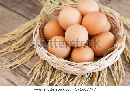 Fresh chicken eggs in a basket - stock photo