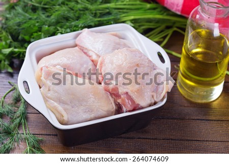 Fresh chicken meat in bowl  on table. Selective focus. Rustic style.  - stock photo