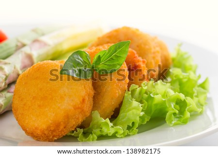 fresh chicken nuggets with asparagus - stock photo
