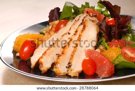 Fresh chicken salad with grapefruit, orange and tomatoes