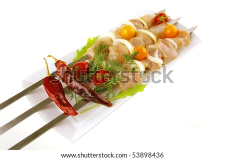 fresh chicken shish kebab on plate with vegetables