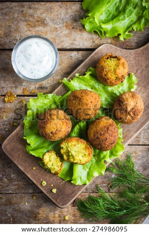 fresh chickpeas falafel  with tzatziki sauce, top view - stock photo