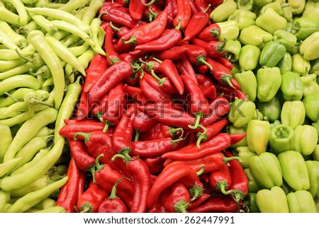 Fresh Chillis and Sweet Peppers on Shelf in Supermarket. - stock photo