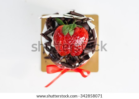 Fresh chocolate cake with strawberries on white background - stock photo