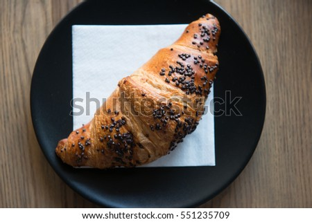Fresh Chocolate Croissant on a napkin in a cafe