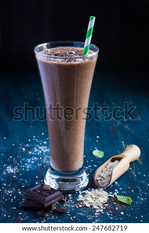 fresh chocolate milk smoothie with oat flakes, selective focus - stock photo