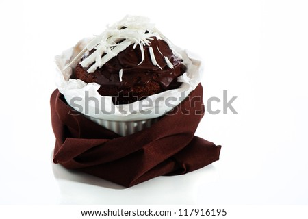 fresh chocolate muffin in a ramekin white chocolate as decoration