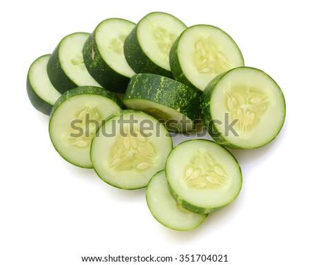 Fresh chopped cucumber vegetables isolated on white background - stock photo