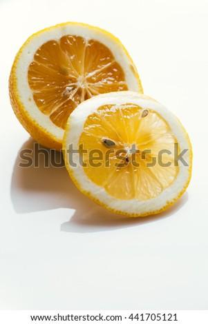 fresh chopped lemon slices on a white background. - stock photo